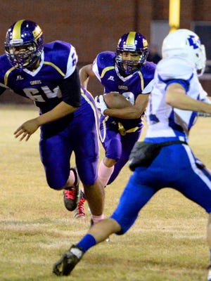 Waynesboro's Steffan Thornton looks for a way through as he runs the ball during the first half of a football game against Fort Defiance played in Waynesboro on Friday, Oct. 24, 2014.