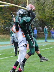 Spackenkill High School's Alex Strom nabs a pass during the Spartans' home win over Dover on Saturday.