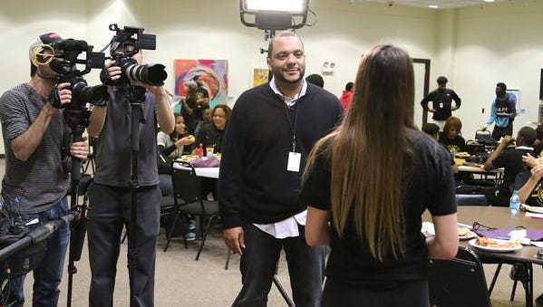 Shawn Wilson, multicultural and community engagement manager for the Ford Motor Company Fund, conducts student interviews during the symposium.