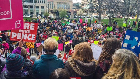 More than 1,000 people gathered at the Indiana Statehouse in a rally against the state's new abortion restrictions  Saturday, April 9, 2016.