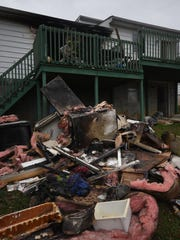 Debris litters the ground following a house fire at 41 Woodstock Road, Fayetteville. The fire reporteddly started in the dryer.