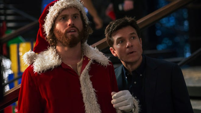 """T.J. Miller (left) and Jason Bateman star in """"Office Christmas Party."""""""