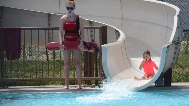 A child prepares to splash down into the Newton Municipal Pool.