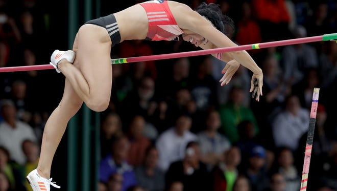 Jenn Suhr clears the bar during the women's pole vault final at the U.S. Olympic Track and Field Trials, Sunday, July 10, 2016, in Eugene Ore.