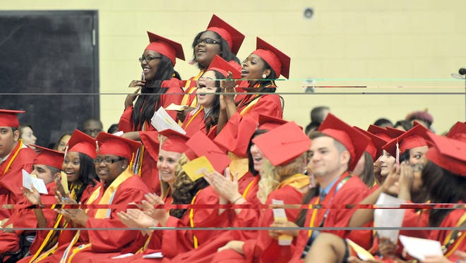 Everett students  cheer the antics of their Class of 2014 valedictorians last June during commencement. The editorial discusses the need for Michigan to make education a higher priority.
