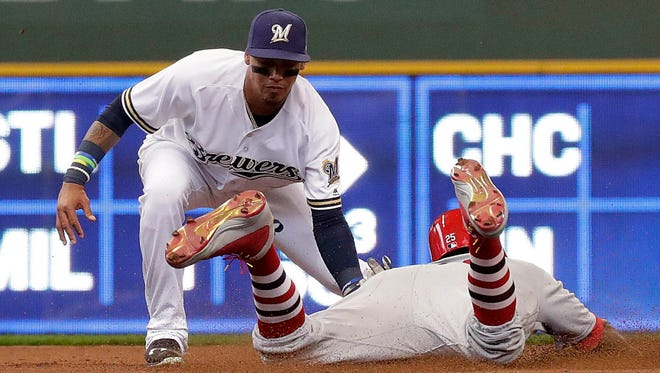 Shortstop Orlando Arcia and the Brewers had trouble keeping the Cardinals off the bases on Monday at Miller Park.