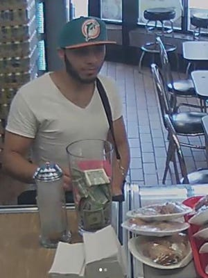 Fairview police seek help finding a man who stole money from two restaurants in town.