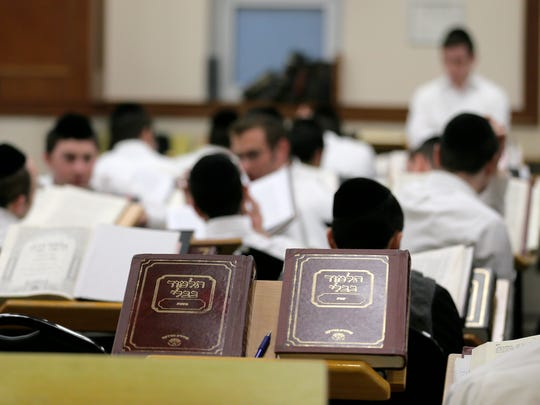 Students work in one of the study halls inside the Israel Henry Beren Hall at Beth Medrash Govoha in Lakewood, NJ Wednesday, February 7, 2018.