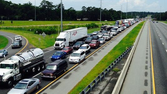 Traffic on I-10 backed up after wreck.