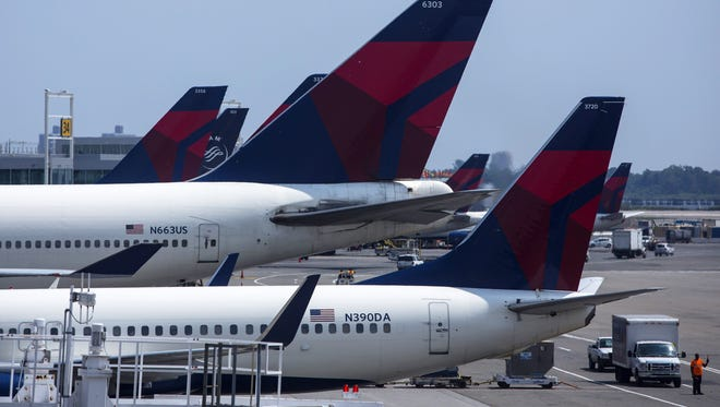 Delta planes sit at Terminal 4 at John F. Kennedy Airport  on July 22, 201.