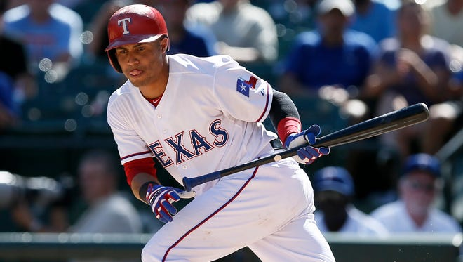 Texas Rangers' Leonys Martin sprints out of the box after a bunt attempt during an interleague baseball game against the San Diego Padres in Arlington, Texas. The Seattle Mariners have acquired Martin from th Rangers in exchange for right-handed relief pitcher Tom Wilhelmsen as part of a four-player trade announced Monday, Nov. 16, 2015.