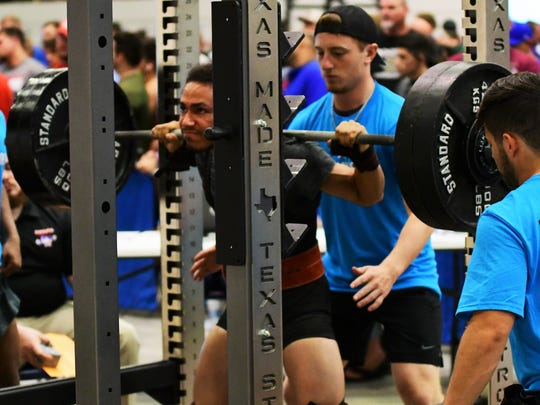 Hawley's Johnny Donnelly makes his second squat attempt during Saturday's state powerlifting meet at the Taylor County Expo Center.
