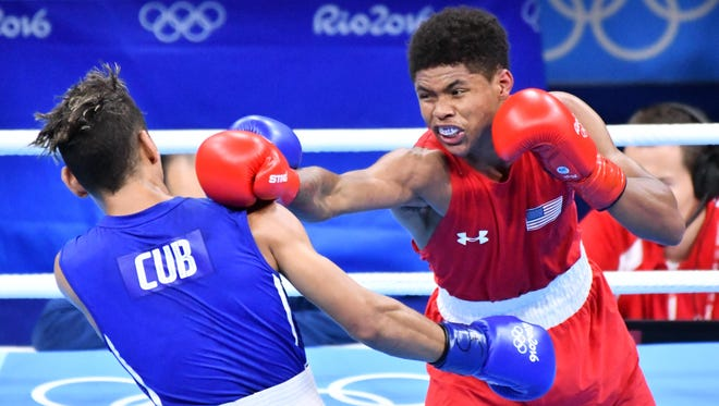 Robeisy Ramirez (CUB), blue, and Shakur Stevenson (USA) compete in a men's bantamweight boxing event during the Rio 2016 Summer Olympic Games at Riocentro - Pavilion 6 on Aug. 20.