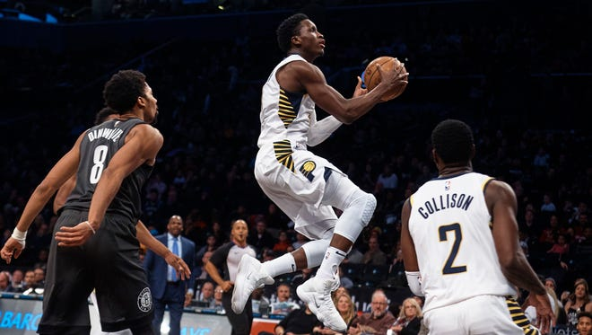 Indiana Pacers' Victor Oladipo, center, drives to the basket in between players during the first half of an NBA basketball game against Brooklyn Nets, Sunday, Dec. 17, 2017, in New York.