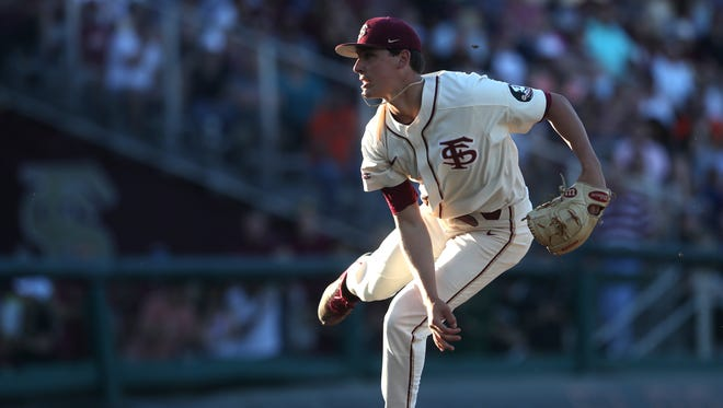 FSU's CJ Van Eyk pitches against Miami during their game at Dick Howser Stadium on Saturday, April 28, 2018.