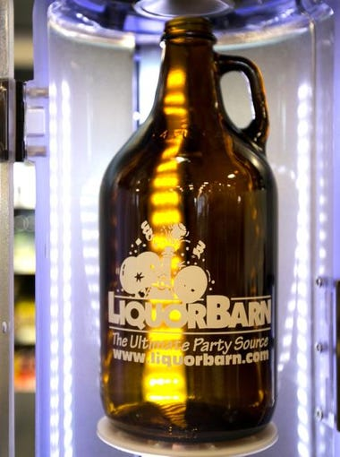 A growlers is ready to be filled at a new Liquor Barn