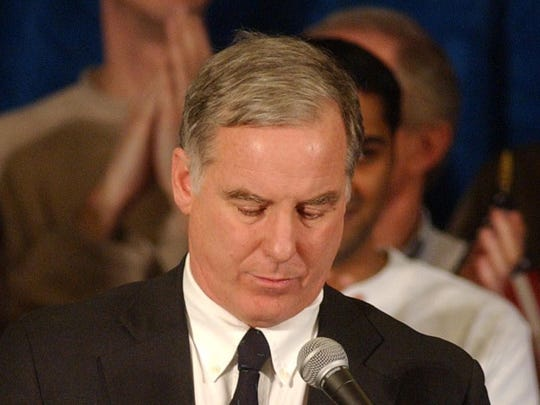 Former Vermont Gov. Howard Dean hangs his head as he announces he was no longer a candidate for the presidential nomination in South Burlington on Feb. 18, 2004. Dean's wife, Dr. Judith Steinberg Dean, is at left.