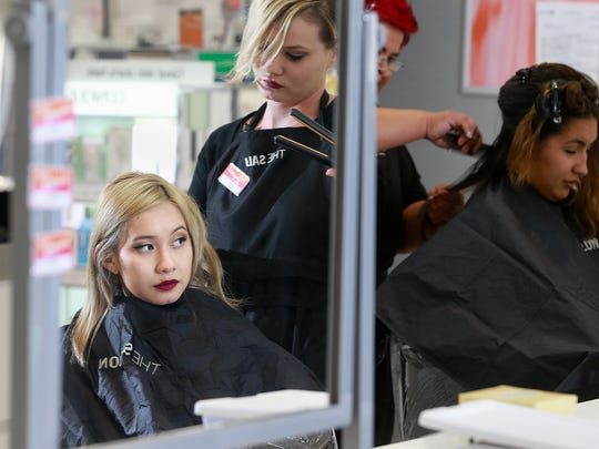 Vivien De La Paz, left, gets her hair toned and styled by Ciara Montgomery on Wednesday at the new Ulta Beauty inside the Animas Valley Mall in Farmington.