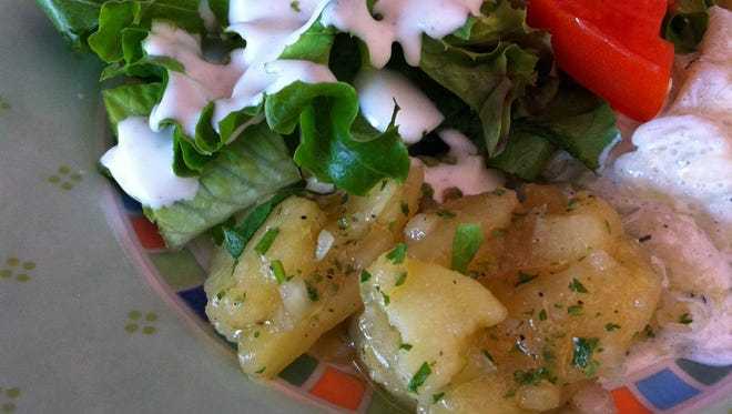 The dinner salad at Heidelberg comes with everything from marinated cucumbers to two types of kartoffelsalat, various vegetables, fresh greens and a light, creamy dressing on a nicely dressed plate