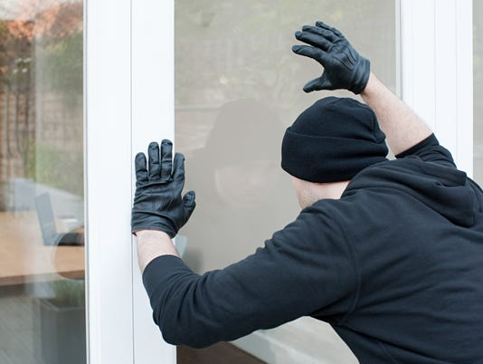 Burglar looking through window