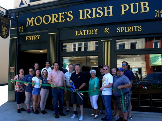636657917091269246-Moores-Irish-Pub-ribbon-cutting.JPG