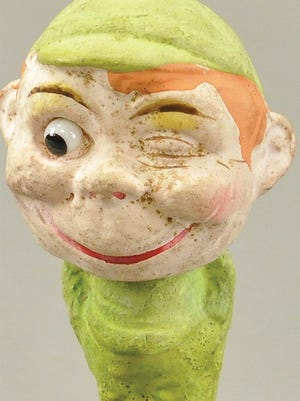 There are many collectors of Christmas and Halloween collectibles, but few celebrate St Patrick's Day with a collection of figures. This smiling leprechaun nods his head as he learns that he was bought for $59 at a Bertoia auction in New Jersey.