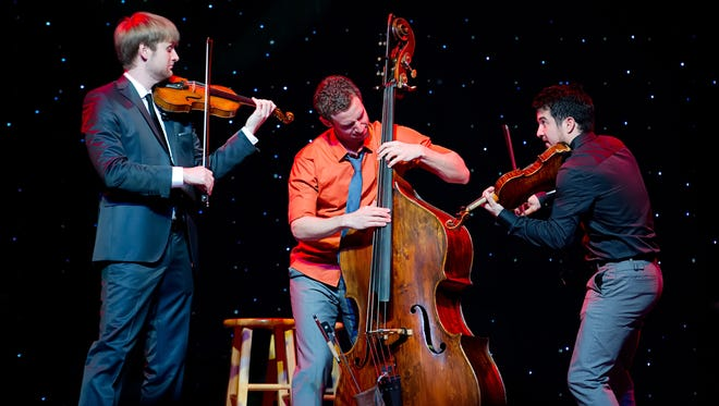 Time for Three includes, (from left), Nick Kendall and Zach De Pue on violin and Ranaan Meyer on double bass.