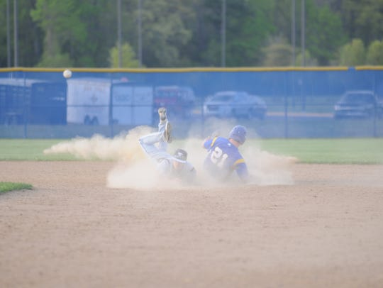 Sussex Tech's Tyler Banning attempts a double play