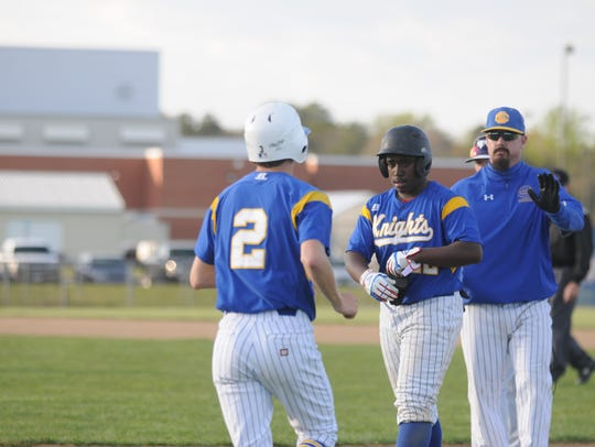 Sussex Central's Trey Toppin comes off to be pinch