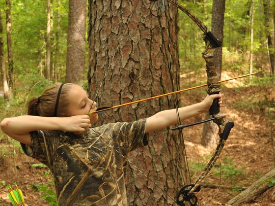 Lena Hines puts the archery knowledge she has learned