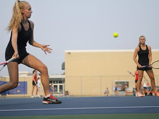 Kaydee Miller plays doubles at the Tigers' doubles tournament on Saturday at South Junior High.