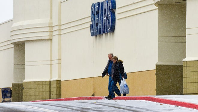 Shoppers come out of Sears after shopping Tuesday, Dec. 12, At Crossroads Center. Sears is planning to close to the public in January after almost 90 years in St. Cloud.