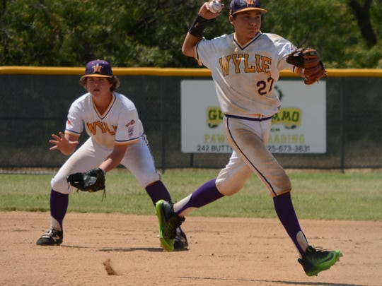 Wylie Junior League shortstop Landon Williams throws to first for an out after stepping in front of second baseman Riley Hood to field a ground ball in Wylie's 3-1 win over Alice American on Tuesday at Kirby Park. The victory secured the Texas West State championship for Wylie.
