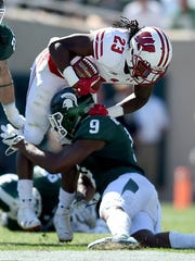 MSU junior safety Montae Nicholson takes down Wisconsin's Dare Ogunbowale during the Badgers' 30-6 win last Saturday at Spartan Stadium.