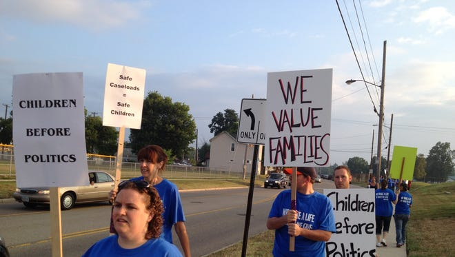 Butler County Children Services caseworkers went on strike after contract negotiations regarding wages fell apart the day before.