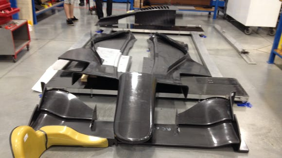The front wing assembly (foreground) is much like the one used in the IndyCar Series; the underwings (rear) come in two pieces.
