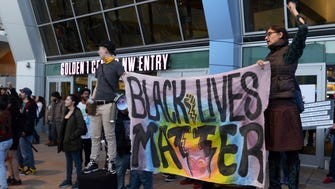 Demonstrators protesting this week's fatal shooting of an unarmed black man gather outside Golden 1 Center before the scheduled tip-off of an NBA game between the Atlanta Hawks and the Sacramento Kings.