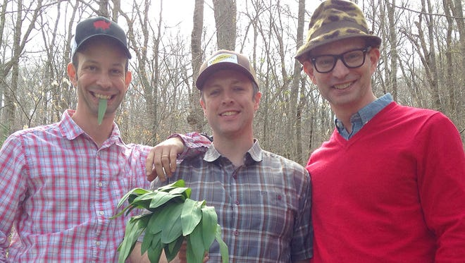 Matt and Ted Lee flank local chef  William Dissen, holding a clutch of ramps.