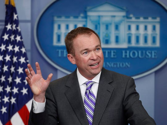 Budget Director Mick Mulvaney speaks to reporters during