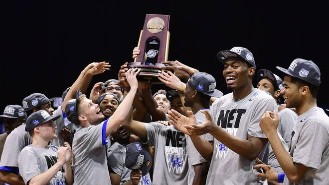 The Kentucky Wildcats celebrate their Midwest Region championship.