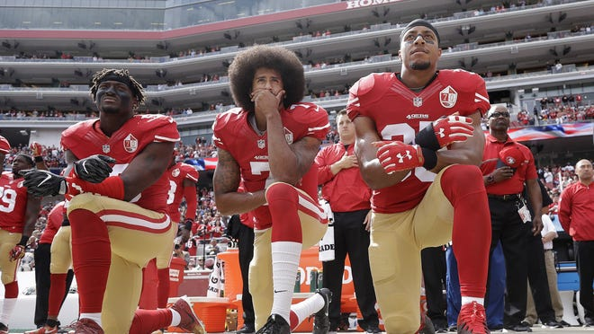 In 2016, 49ers quarterback Colin Kaepernick, center, was joined by teammates Eli Harold, left, and Eric Reid to take a stand against police brutality and racial injustice. He took plenty of heat for kneeling during the anthem but four years later, the perspective is different.