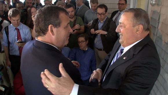 New Jersey Gov. Chris Christie, left, accepts the endorsement