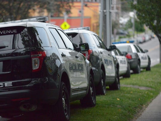 Police cars line up along Pine Street in Burlington