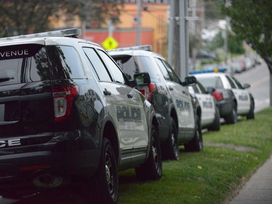 Police cars line up along Pine Street in Burlington during a standoff involving police, mental-health professionals and a distraught woman Thursday night, June 9, 2016.