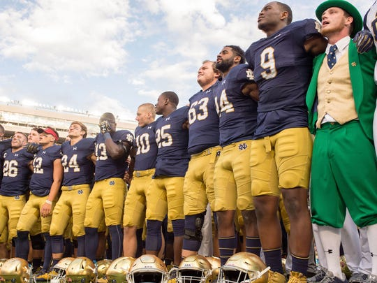 The Notre Dame Fighting Irish sing the Notre Dame Alma Mater after defeating the Temple Owls at Notre Dame Stadium.
