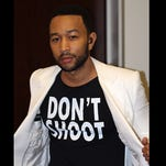 """Singer John Legend shows Legend wearing a T-Shirt that says """"Don't Shoot,"""" in reference to the Aug. 9 shooting of Michael Brown in Ferguson, Mo., at the Hollywood Bowl in Los Angeles. Legend performed Marvin Gaye's What's Going on with the Los Angeles Philharmonic."""