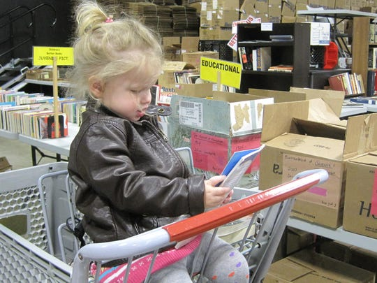 The Friends of the Library book sales held in spring and fall are a frugal way to build your own library of children's books at home.