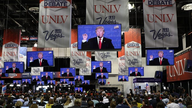 Members of the media watch the third presidential debate with republican presidential nominee Donald Trump democratic presidential nominee former Secretary of State Hillary Clinton in the media center the Thomas & Mack Center on October 19 in Las Vegas.