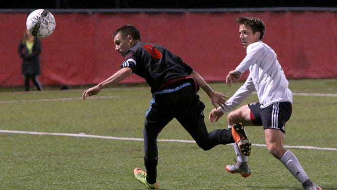 Arrowhead's Luke Dubnicka and Eau Claire Memorial's Joe Free battle for the ball during WIAA Division 1 State semifinal play on Nov. 2. at Uihlein Soccer Park.