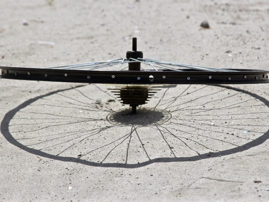 A bicycle wheel lays on the ground of the lot where Scot Breithaupt was found dead in a tent in Indio. Breithaupt was a founder of bicycle motocross and a National BMX Hall of Fame member.